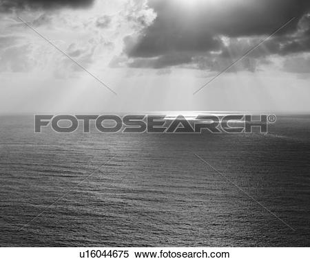 Stock Image of Shafts of sunlight shining through cloud and a view.