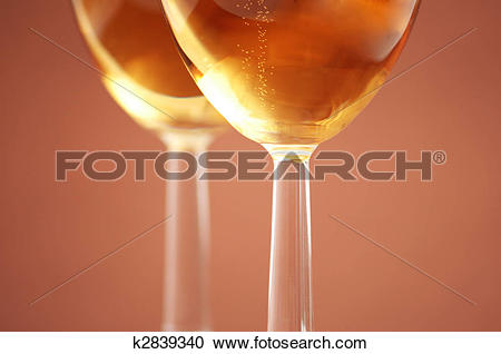 Stock Photography of Two wine glasses with shallow depth of field.