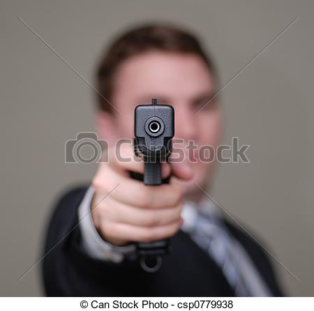 Pictures of Businessman Points Gun with Shallow Depth of Field.