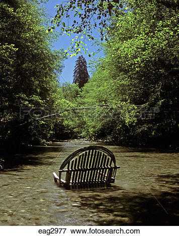 Picture of An outdoor CHAIR or COUCH made of willows sits.