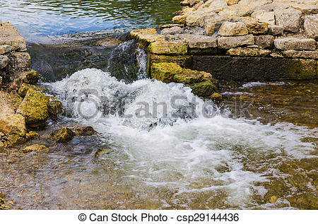 Stock Photos of stream shallow river around stones csp29144436.