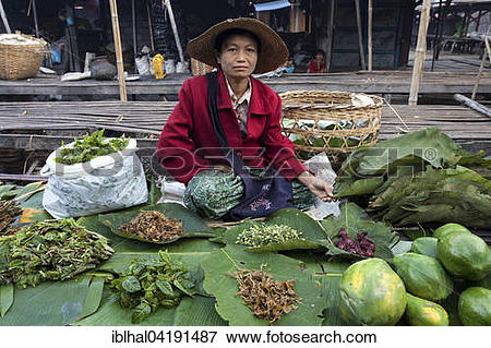 Picture of Local woman selling vegetables in the market in.