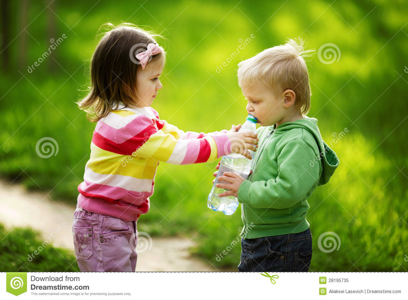 Sharing A Bottle Of Water Stock Image.