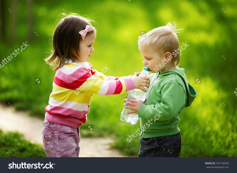 Boy Girl Sharing Bottle Water Stock Photo 107136959.