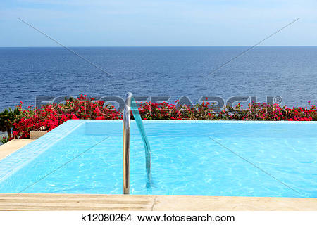 Stock Photo of The infinity sea view swimming pool with jacuzzi at.