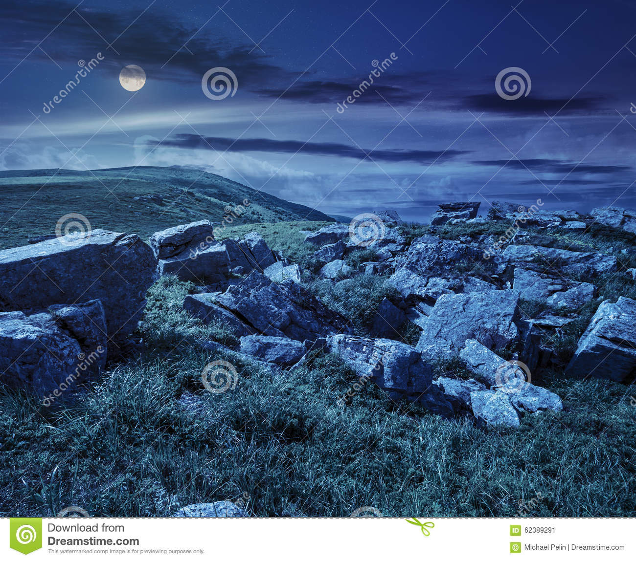 Boulders On The Mountain Meadow At Night Stock Photo.