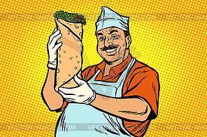 Smiling Oriental street food chef. Kebab Shawarma.