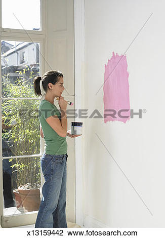 Stock Photo of Woman Contemplating a Pink Colour Swatch she has.