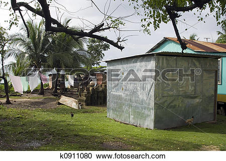 Stock Photography of sheet metal house and yard caribbean k0911080.