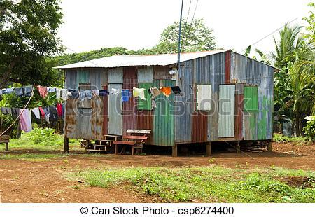 Stock Photography of ramshackle zinc house laundry hanging Corn.