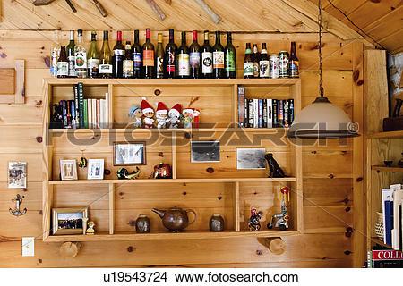 Stock Photo of cabin, memorabilia, pine, knotty, shelved.