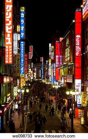 Stock Photo of Busy scene at night with many bright, glowing signs.