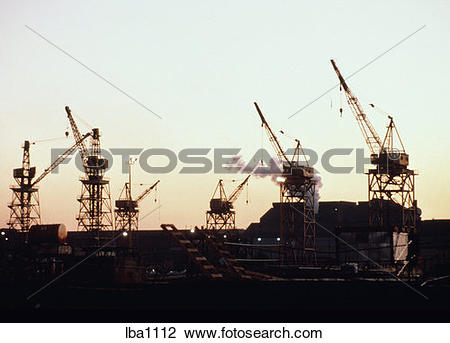 Stock Photo of Construction cranes in shipbuilding yard in.