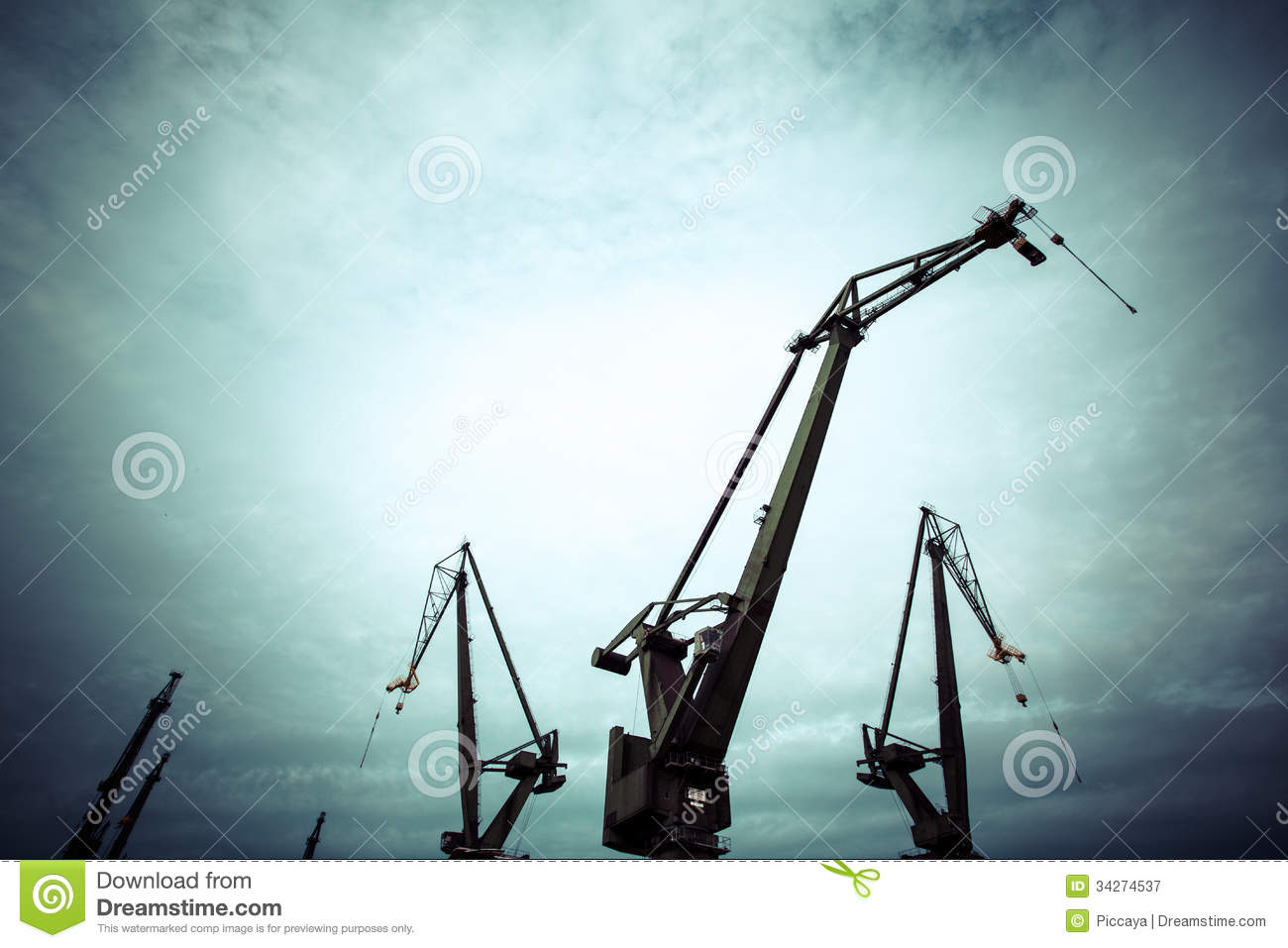 Silhouettes Of Industrial Cranes In Gdansk Shipyard Royalty Free.