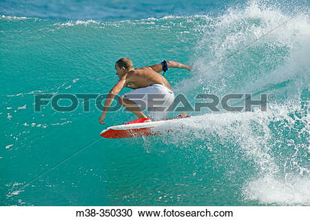 Stock Photography of Man boogie boarding. Shipwreck Beach, Poipu.