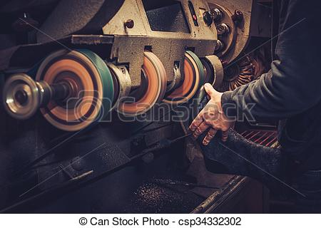 Stock Photography of Shoemaker performs shoes in the studio craft.