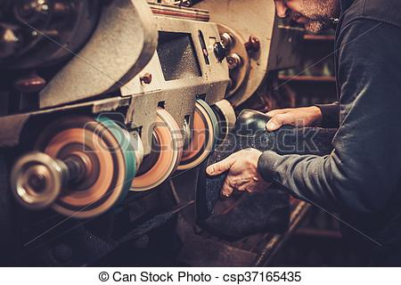 Stock Photos of Shoemaker performs shoes in the studio craft.