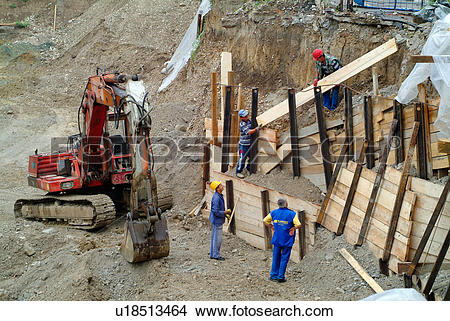 Stock Photo of Workmen shoring up the sides of a site u18513464.