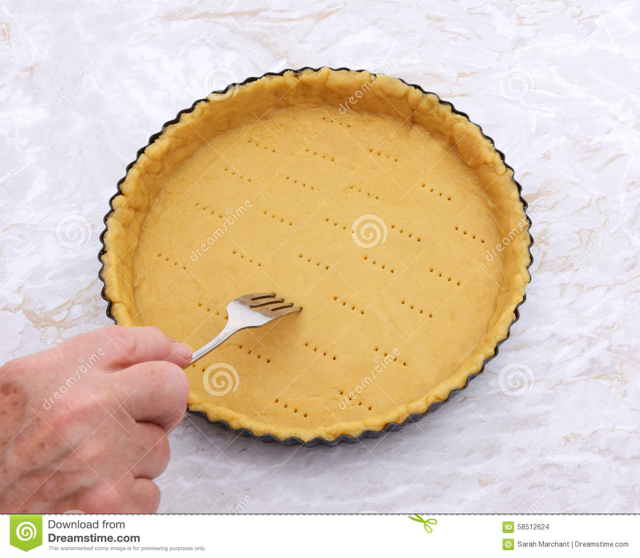 Pricking Shortcrust Pastry Case With A Metal Fork Stock Photo.