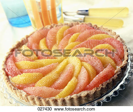 Stock Photography of Citrus fruit tart with balsamic vinegar.