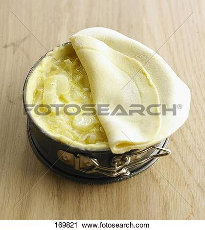 Stock Photography of Covering the pie with shortcrust pastry.
