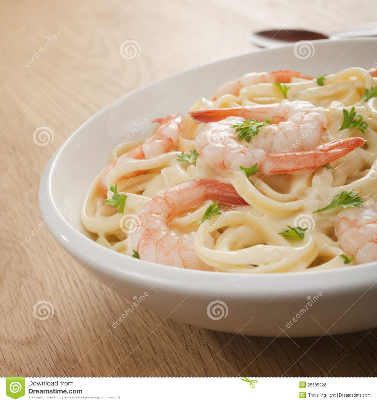 Pasta Fettucine Alfredo With Shrimp Or Prawns Stock Photos.