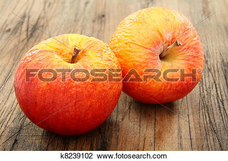 Stock Photo of Two shriveled apples. k8239102.