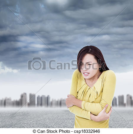 Stock Photo of Young woman shudder and tightening body in outdoors.