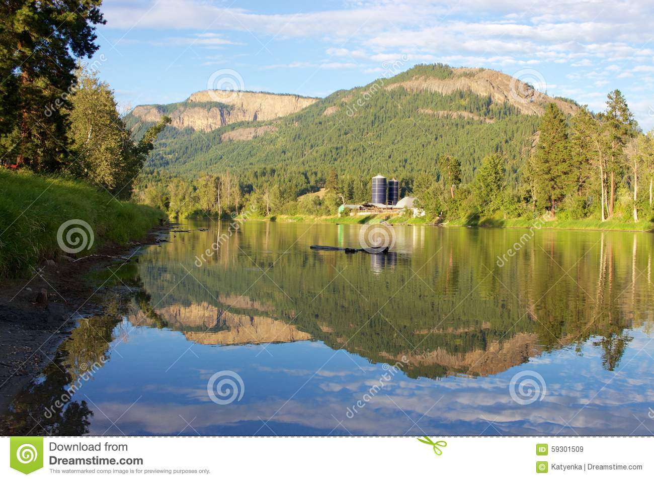 Enderby Cliffs Reflecting In Shuswap River, Enderby, British.