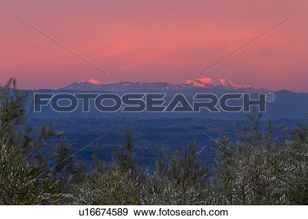 Stock Photograph of Alpenglow and glorious pink sky on snow capped.