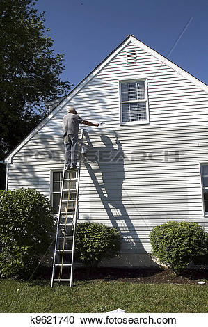 Stock Photography of Man Painting Side of House k9621740.