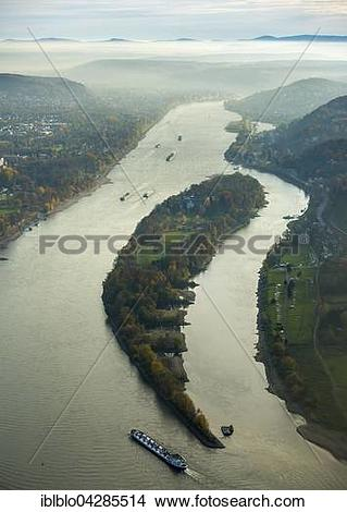Stock Photo of Rhine with cargo ships in the mist, Rhine island.