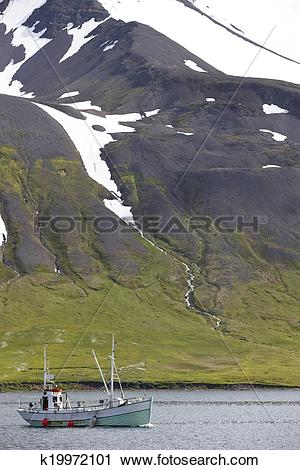 Stock Photography of Iceland. Siglufjordur fiord with fishing boat.