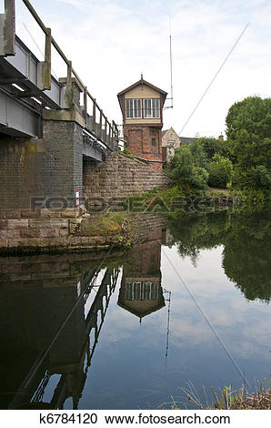 Stock Photography of Old working signal box from across the river.