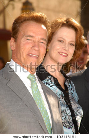 Arnold Schwarzenegger And Sigourney Weaver Stock Photos, Royalty.