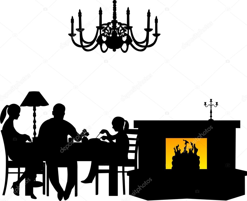 Family having their dinner at the table next to the fireplace in.