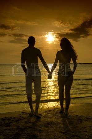 Couple enjoying their time at the sunrise on the beach couple.