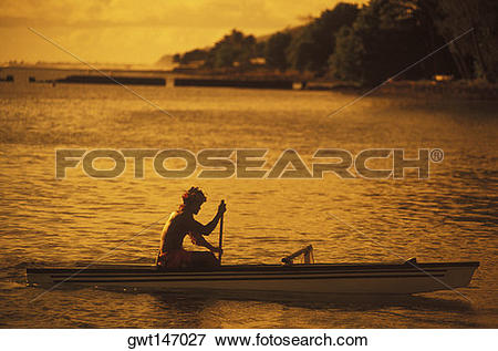 Picture of Silhouette of a person rowing a boat at dusk, Hawaii.