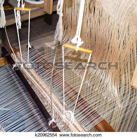 Stock Photo of Silk production factory. Traditional manufacturing.