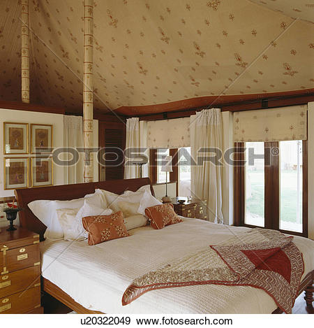 Stock Photograph of White linen pillows and silk cushions on.