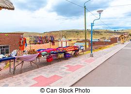 Stock Photo of Souvenir market near towers in Sillustani, Peru.
