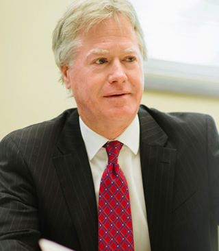 John B. Simpson, Charlottesville Commercial Litigation Attorney.