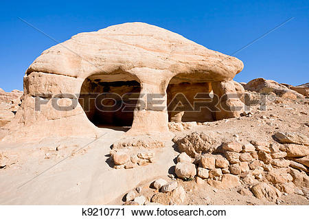 Stock Photography of stone cave home in Bab as.