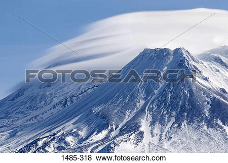 Pictures of Clouds over a snow covered mountain, Mt Shasta.