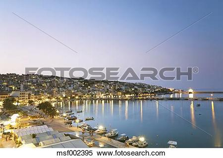 Stock Image of Greece, Crete, Sitia, View of city with harbor at.