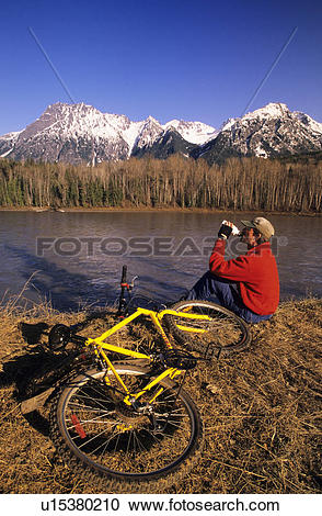Stock Photography of Mountain biking beside Skeena river, Hazelton.