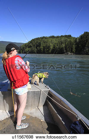 Pictures of Young girl catching bull trout, Skeena river, British.