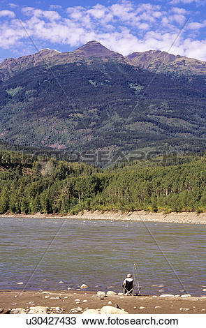 Stock Photo of Angler bar fishing at Boulder Creek on the Skeena.
