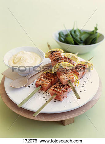 Stock Images of Salmon brochettes with lemon and herbs,spinach.