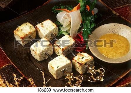 Stock Photograph of Paneer tikka (pieces of cheese on skewer with.